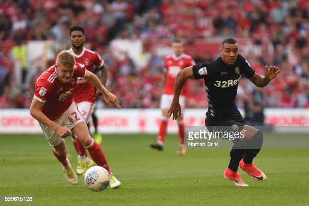 JayRoy Grot of Leeds United and Joe Worrall of Nottingham Forest in action during the Sky Bet Championship match between Nottingham Forest and Leeds...