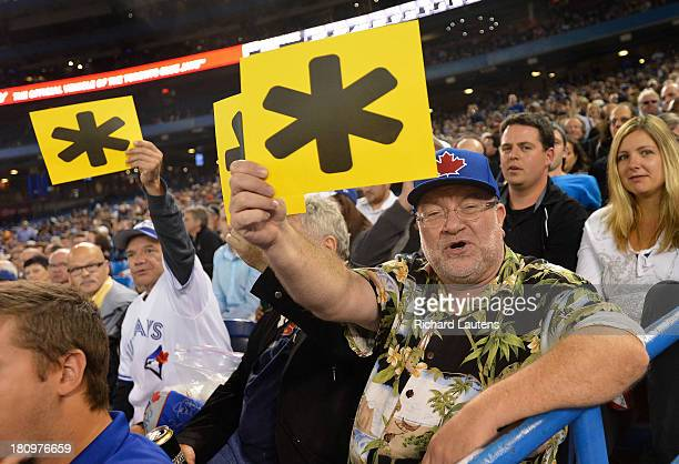 TORONTO ON SEPTEMBER 18 Jays fans hold up asterisk posters whenever New York Yankees third baseman Alex Rodriguez comes up to batfor the asterisk...