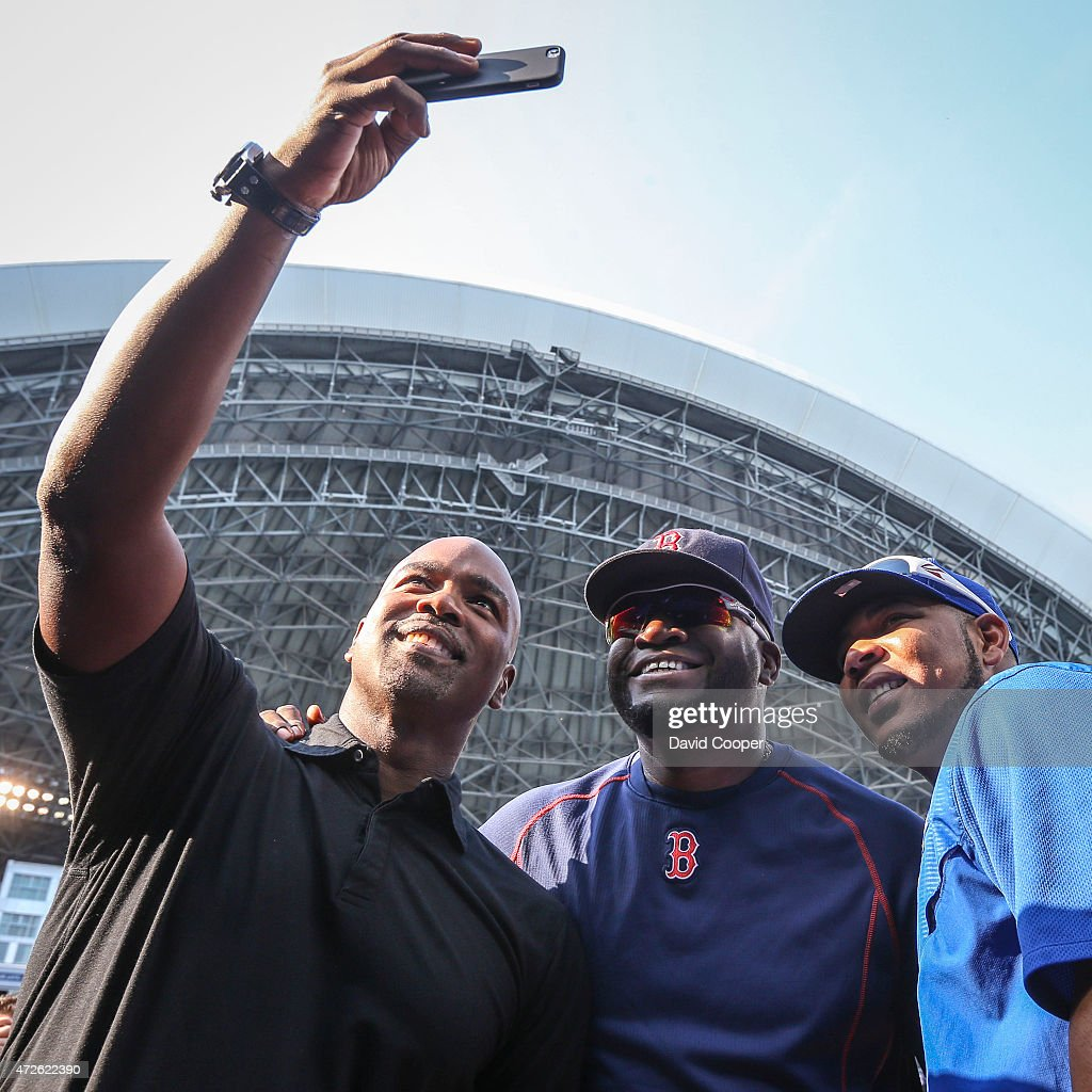 TORONTO, ON- MAY 8 - Jays great Carlos Delgado takes a selfie with Boston Slugger David Ortiz, and Edwin Encarnacion during batting practice before the game between the Toronto Blue Jays and the Boston Red Sox at the Rogers Centre May 8, 2015