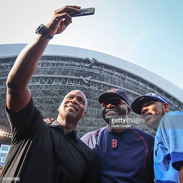 TORONTO ON MAY 8 Jays great Carlos Delgado takes a selfie with Boston Slugger David Ortiz and Edwin Encarnacion during batting practice before the...