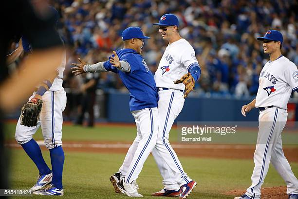 TORONTO ON JULY 8 Jays' Marcus Stroman Troy Tulowitzki and Darwin Barney celebrate their win over the Royals as the Toronto Blue Jays hosted the...
