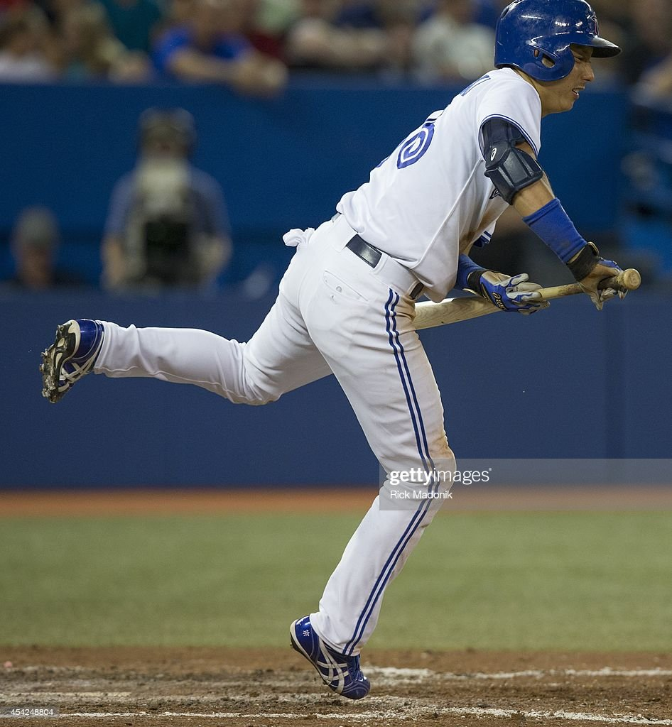 TORONTO - AUGUST 26 - Jays Munenori Kawasaki dances out of the way of a pitch. Toronto Blue Jays Vs Boston Red Sox during MLB action at Rogers Centre on August 26, 2014.