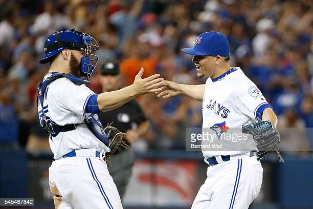 TORONTO ON JULY 8 Jays Roberto Osuna celebrates with catcher Russell Martinas the Jays beat the Royals as the Toronto Blue Jays hosted the Detroit...