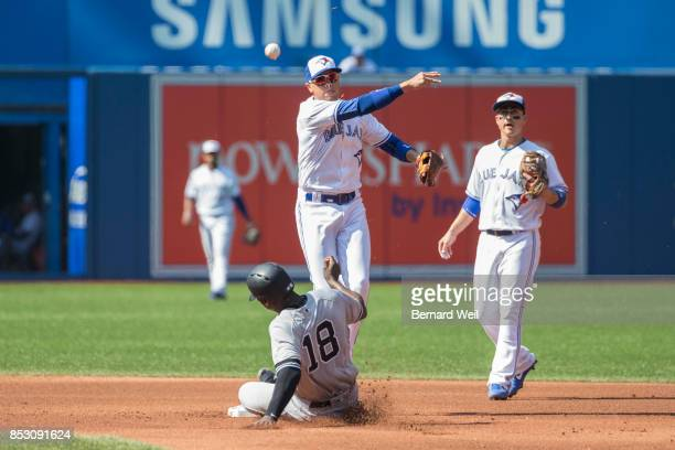 TORONTO ON SEPTEMBER 24 Jays' Ryan Goins can't get the ball to first baseman Justin Smoak to complete the double play as Yankees' Didi Gregorius...
