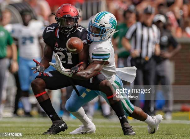 Jayshon Jackson of the Cincinnati Bearcats looks to catch the ball that was eventually broken up by Donnie Lewis Jr. #1 of the Tulane Green Wave at...