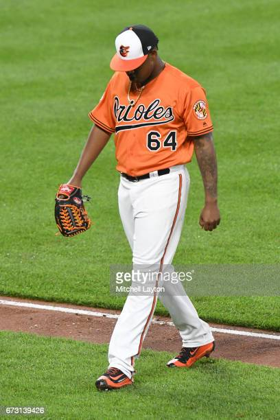 Jayson Aquino of the Baltimore Orioles walks back to the dug out during a baseball game against the Boston Red Sox at Oriole Park at Camden Yards on...