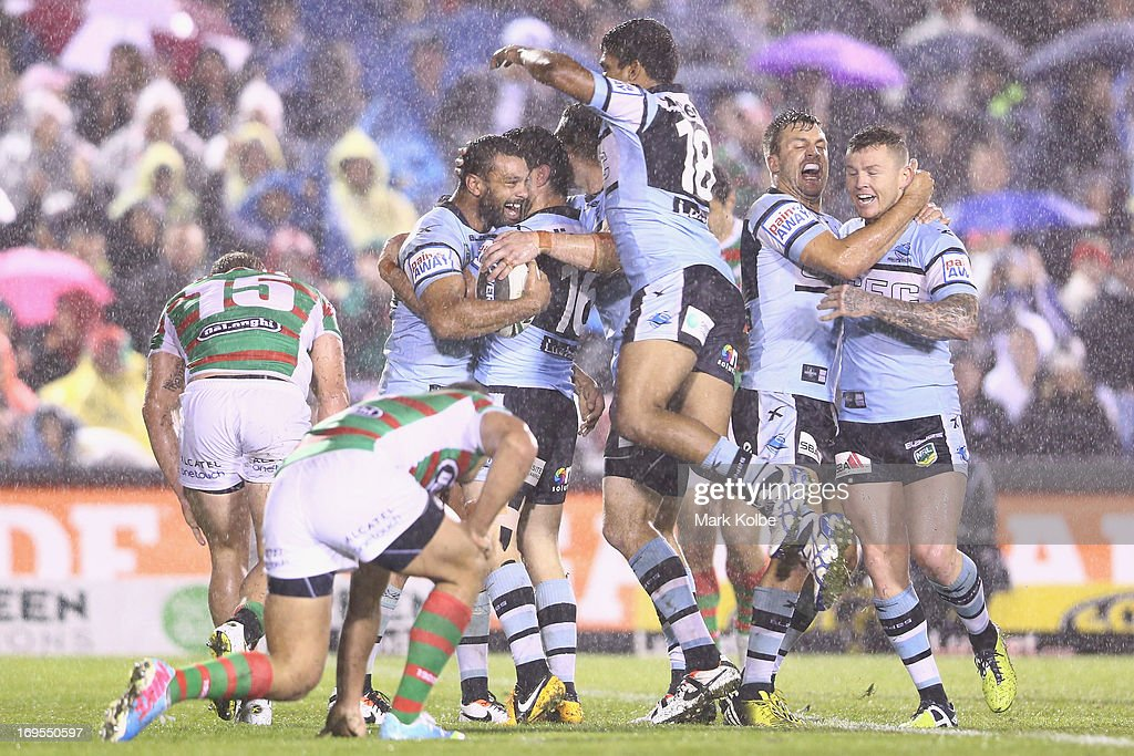 Jayson Bukuya of the Sharks celebrates with his team mates after scoring a try during the round 11 NRL match between the Cronulla Sharks and the South Sydney Rabbitohs at Sharks Stadium on May 27, 2013 in Sydney, Australia.
