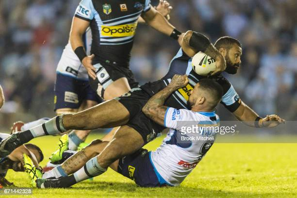 Jayson Bukuya of the Sharks is tackled by Nathan Peats of the Titans during the round eight NRL match between the Cronulla Sharks and the Gold Coast...