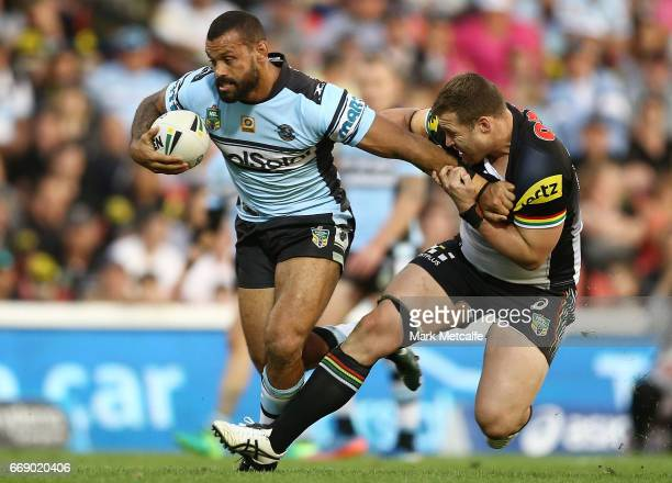 Jayson Bukuya of the Sharks is tackled by Trent Merrin of the Panthers during the round seven NRL match between the Penrith Panthers and the Cronulla...