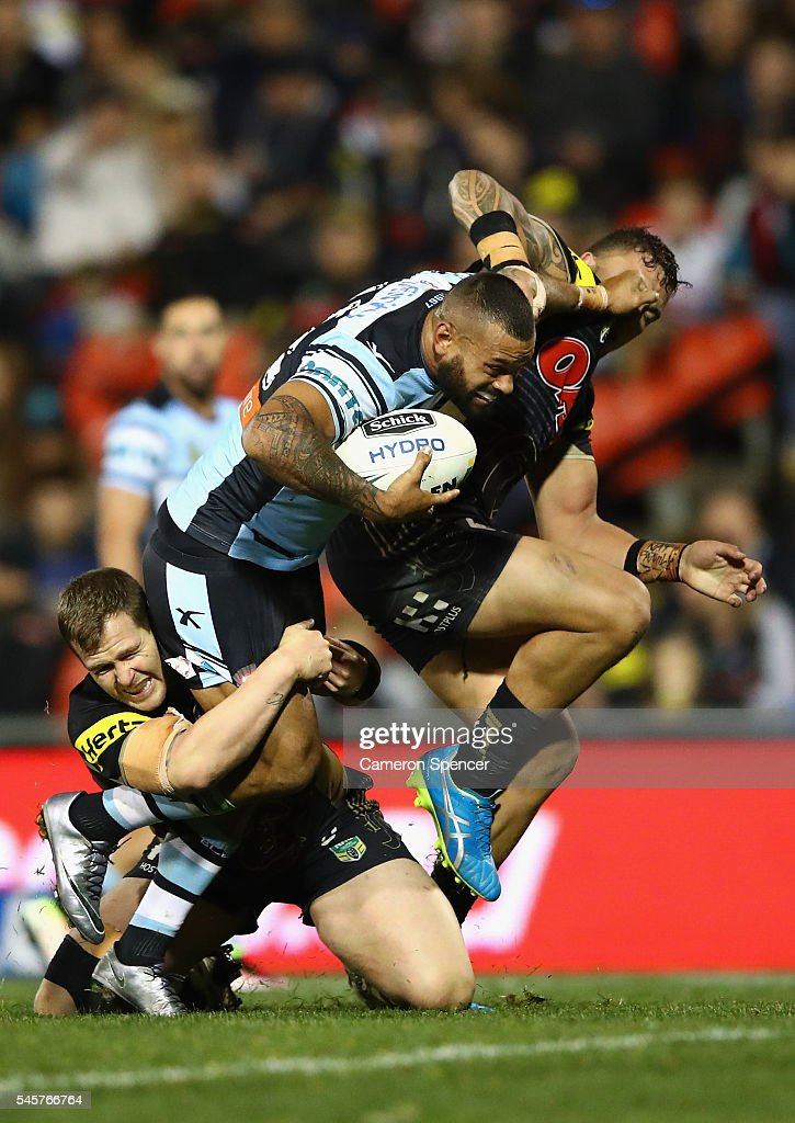 Jayson Bukuya of the Sharks is tackled during the round 18 NRL match between the Penrith Panthers and the Cronulla Sharks at Pepper Stadium on July 10, 2016 in Sydney, Australia.