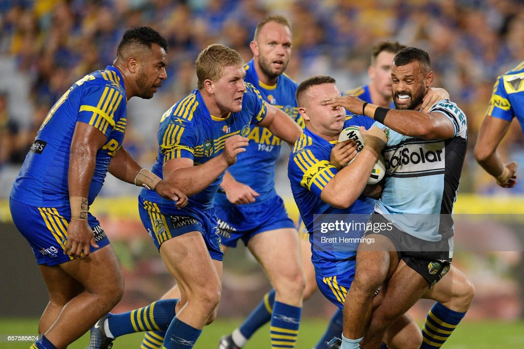 Jayson Bukuya of the Sharks is tackled during the round four NRL match between the Parramatta Eels and the Cronulla Sharks at ANZ Stadium on March 25, 2017 in Sydney, Australia.