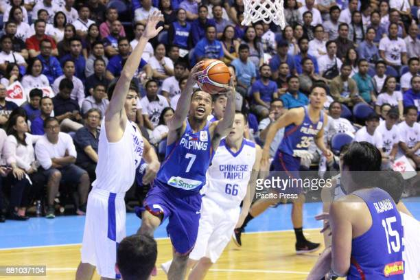 Jayson Castro William of the Philippines drives past several players from Chinese Taipei to convert an uncontested layup during their FIBA World Cup...