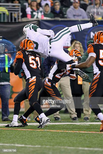 Jayson DiManche and Brandon Ghee of the Cincinnati Bengals up ends quarterback Matt Simms of the New York Jets during their game at Paul Brown...