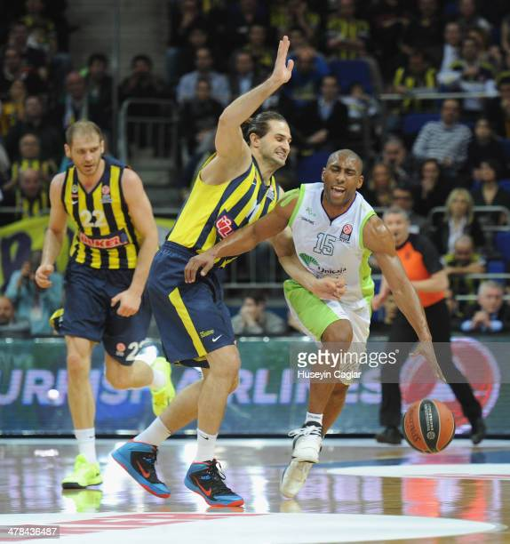 Jayson Granger 15 of Unicaja Malaga competes with Linas Kleiza #11 of Fenerbahce Ulker Istanbul in action during the 20132014 Turkish Airlines...