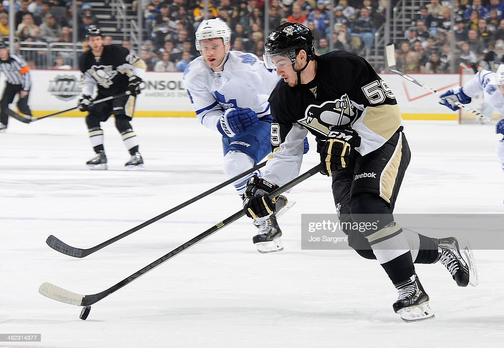 Jayson Megna #59 of the Pittsburgh Penguins moves the puck against the Toronto Maple Leafs on November 27, 2013 at Consol Energy Center in Pittsburgh, Pennsylvania.