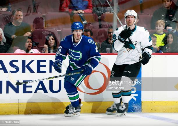 Jayson Megna of the Vancouver Canucks and Jannik Hansen of the San Jose Sharks skate up ice during their NHL game at Rogers Arena April 2 2017 in...