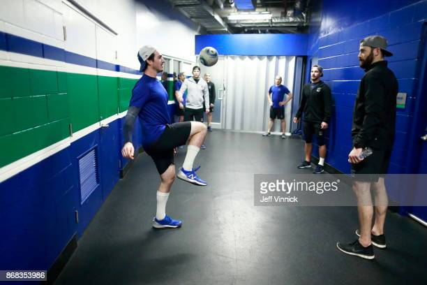 Jayson Megna of the Vancouver Canucks knees a soccer ball as he warms up with teammates before their NHL game against the Dallas Stars at Rogers...
