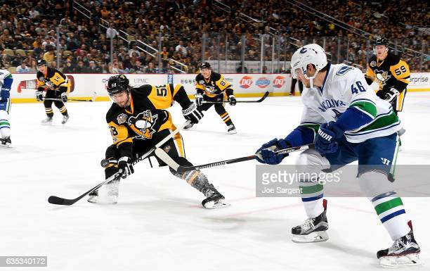 Jayson Megna of the Vancouver Canucks makes a pass in front of Kris Letang of the Pittsburgh Penguins at PPG Paints Arena on February 14 2017 in...