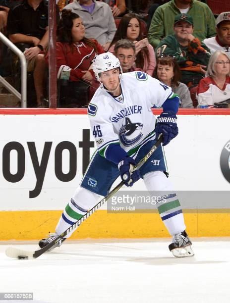 Jayson Megna of the Vancouver Canucks skates the puck up ice against the Arizona Coyotes at Gila River Arena on April 6 2017 in Glendale Arizona