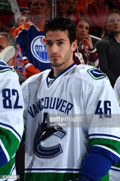 Jayson Megna of the Vancouver Canucks stands for the singing of the national anthem prior to the game against the Edmonton Oilers on April 9 2017 at...