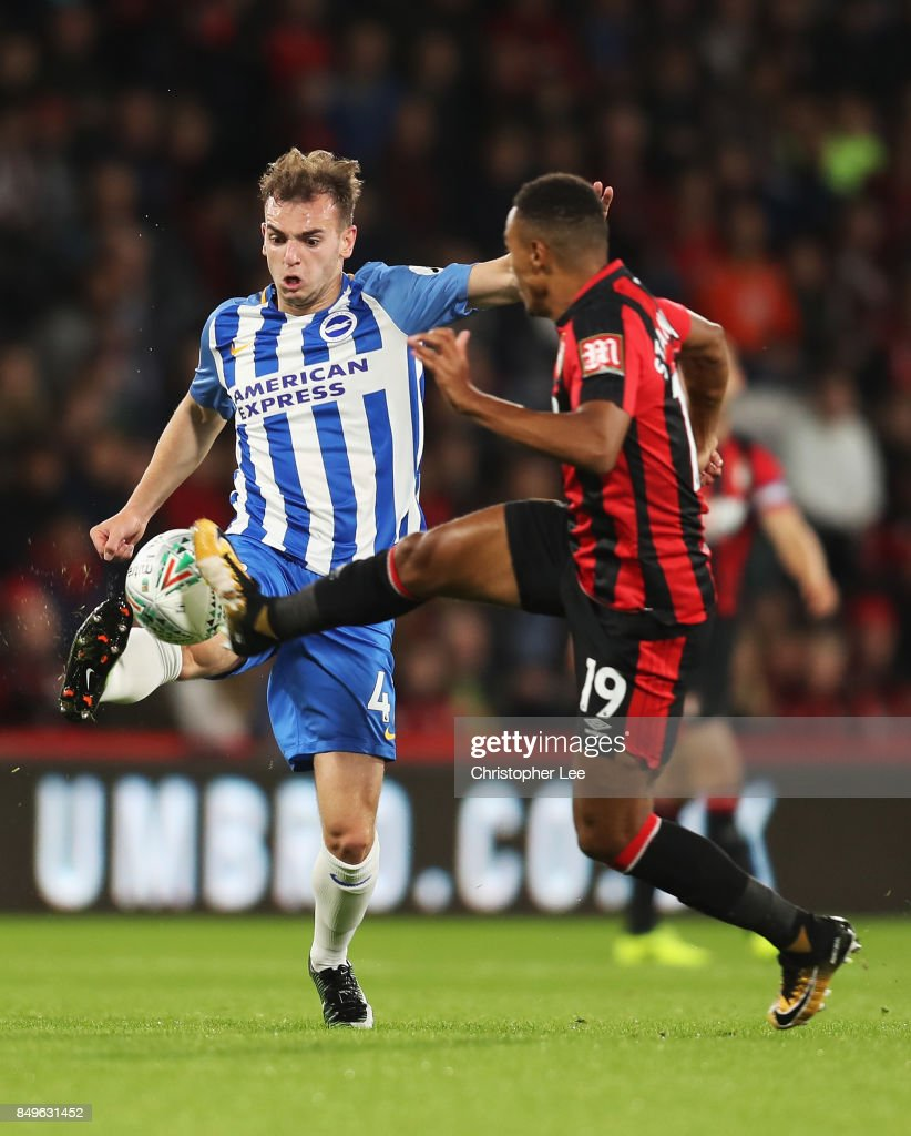 Jayson Molumby of Brighton and Hove Albion and Junior Stanislas of AFC Bournemouth battle for possession during the Carabao Cup Third Round match between AFC Bournemouth and Brighton and Hove Albion at Vitality Stadium on September 19, 2017 in Bournemouth, England.
