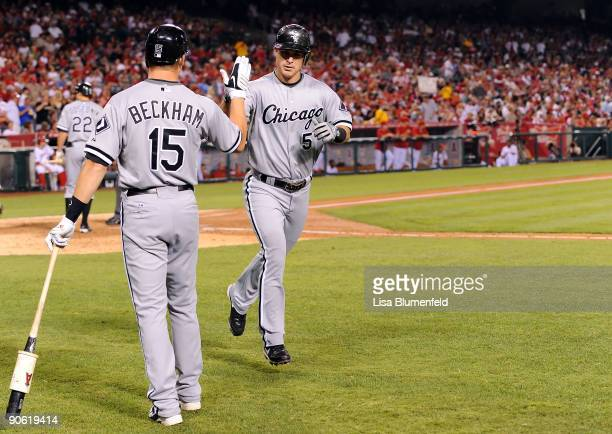Jayson Nix of the Chicago White Sox is congratulated by teammate Gordon Beckham after hitting a homerun in the third inning against the Los Angeles...