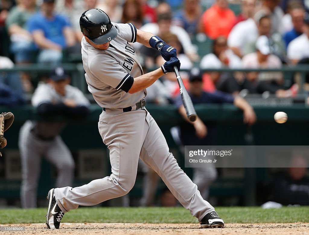 Jayson Nix #17 of the New York Yankees hits an RBI single in the seventh inning against the Seattle Mariners at Safeco Field on June 8, 2013 in Seattle, Washington. The Yankees defeated the Mariners 3-1.