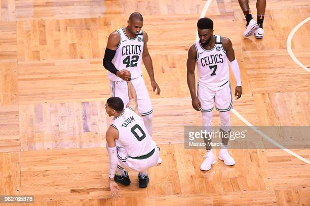 Jayson Tatum Al Horford and Jaylen Brown of the Boston Celtics react during the game against of the Cleveland Cavaliers on Game Five of the 2018 NBA...