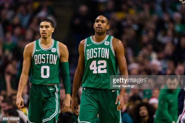 Jayson Tatum and Al Horford of the Boston Celtics walk up the court during the game against the Washington Wizards at TD Garden on December 25 2017...