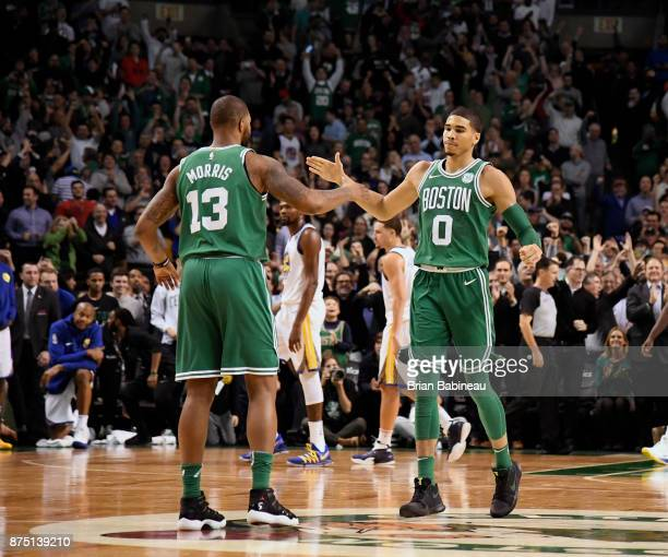 Jayson Tatum and Marcus Morris of the Boston Celtics high five after the game against the Golden State Warriors on November 16 2017 at the TD Garden...