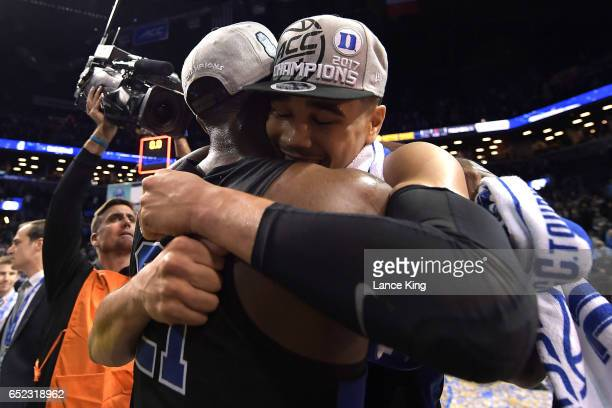 Jayson Tatum hugs Amile Jefferson of the Duke Blue Devils following their 7569 victory against the Notre Dame Fighting Irish during the ACC...