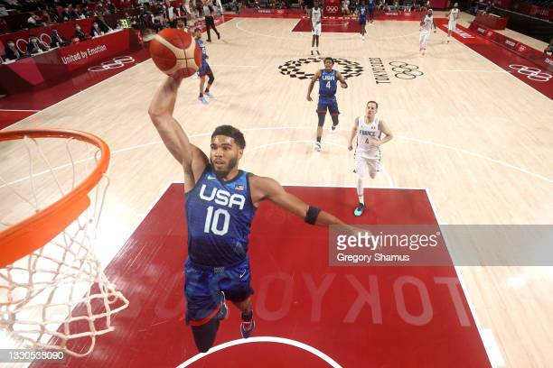 Jayson Tatum of Team United States dunks against Team France during the first half of the Men's Preliminary Round Group B game on day two of the...