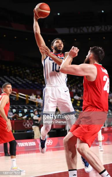 Jayson Tatum of Team United States goes up for a shot against Aaron Geramipoor of Team Iran during the first half of a Men's Preliminary Round Group...