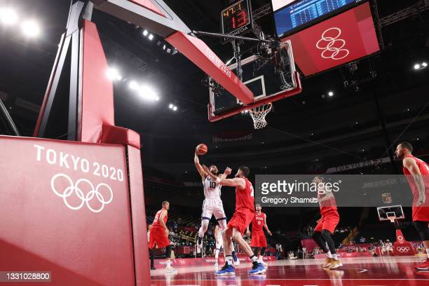 Jayson Tatum of Team United States shoots against Aaron Geramipoor of Team Iran during the first half of a Men's Preliminary Round Group A game on...