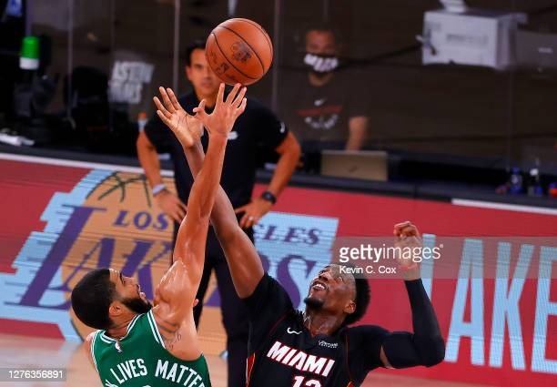 Jayson Tatum of the Boston Celtics and Bam Adebayo of the Miami Heat with a jump ball during the fourth quarter in Game Four of the Eastern...