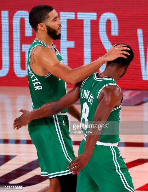 Jayson Tatum of the Boston Celtics and Kemba Walker of the Boston Celtics react after their win over Miami Heat in Game Three of the Eastern...