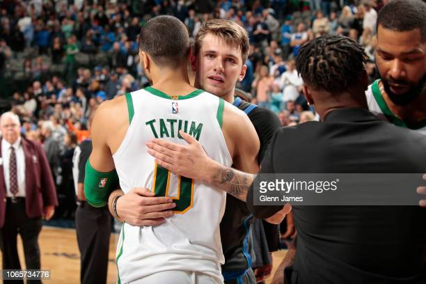 Jayson Tatum of the Boston Celtics and Luka Doncic of the Dallas Mavericks hug after the game on November 24 2018 at the American Airlines Center in...