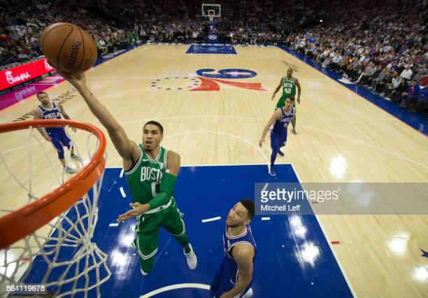 Jayson Tatum of the Boston Celtics attempts a lay up against Ben Simmons of the Philadelphia 76ers in the first quarter at the Wells Fargo Center on...