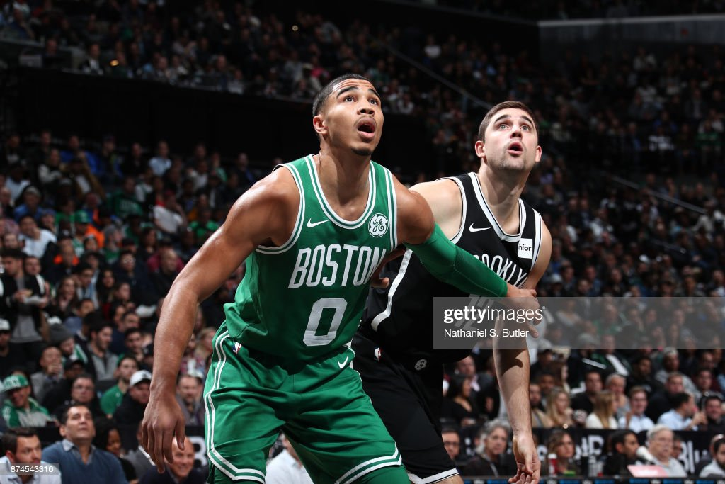 Jayson Tatum #0 of the Boston Celtics boxes out Joe Harris #12 of the Brooklyn Nets on November 14, 2017 at Barclays Center in Brooklyn, New York.