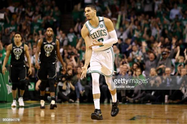 Jayson Tatum of the Boston Celtics celebrates after hitting three point shot during the second quarter against the Milwaukee Bucks in Game Five in...