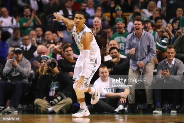 Jayson Tatum of the Boston Celtics celebrates after sinking a three point shot against the Miami Heat during the second quarter at TD Garden on...