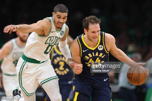 Jayson Tatum of the Boston Celtics defends Bojan Bogdanovic of the Indiana Pacers during the third quarter of Game Two of Round One of the 2019 NBA...