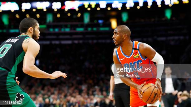Jayson Tatum of the Boston Celtics defends Chris Paul of the Oklahoma City Thunder during the first quarter of the game at TD Garden on March 08 2020...
