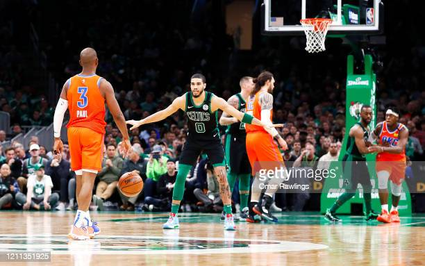 Jayson Tatum of the Boston Celtics defends Chris Paul of the Oklahoma City Thunder as he brings the ball up court during the fourth quarter of the...