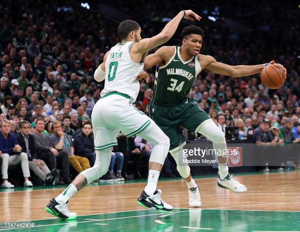 Jayson Tatum of the Boston Celtics defends Giannis Antetokounmpo of the Milwaukee Bucks during the second half of Game 4 of the Eastern Conference...