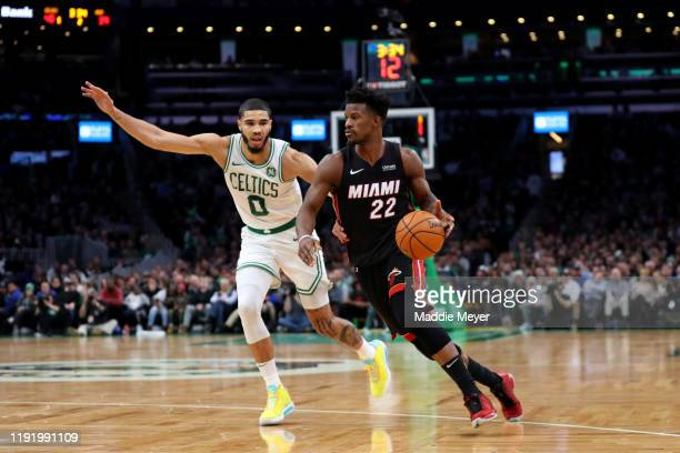 Jayson Tatum of the Boston Celtics defends Jimmy Butler of the Miami Heat during the first half of the game between the Boston Celtics and the Miami...
