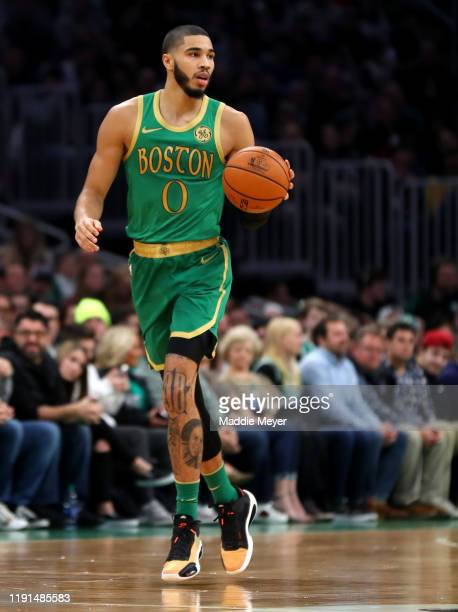 Jayson Tatum of the Boston Celtics dribbles downcourt during the first half of the game against the Brooklyn Nets at TD Garden on November 27 2019 in...