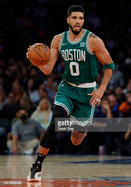 Jayson Tatum of the Boston Celtics dribbles during the second half against the New York Knicks at Madison Square Garden on October 20, 2021 in New...
