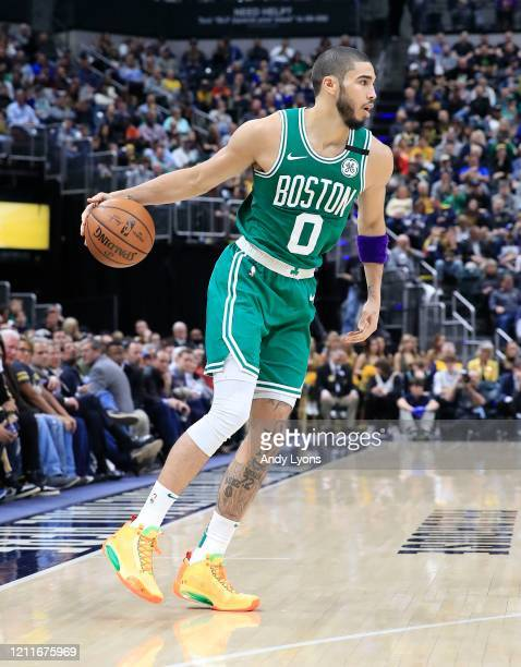 Jayson Tatum of the Boston Celtics dribbles the ball against the Indiana Pacers at Bankers Life Fieldhouse on March 10 2020 in Indianapolis Indiana...