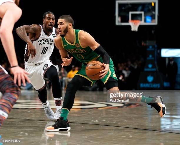 Jayson Tatum of the Boston Celtics drives past Iman Shumpert of the Brooklyn Nets in an NBA basketball game on November 29 2019 at Barclays Center in...